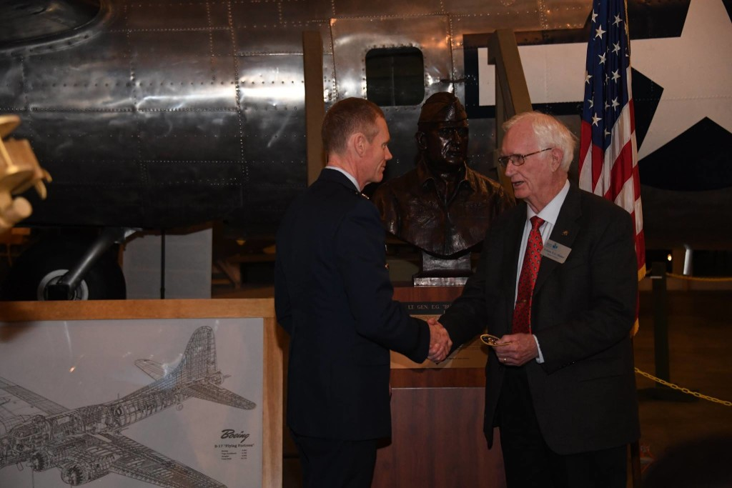 "U.S. Air Force Maj. Gen James Dawkins, Jr., 8th Air Force and Joint-Global Strike Operations Center commander, presents retired Lt. Gen. E.G. ""Buck"" Shuler, a former 8th Air Force commander, an Eighth Air Force 75th anniversary coin and patch during the 28th Anniversary Reunion of Operation Secret Surprise at the National Mighty Eighth Museum in Savannah, Ga., Jan. 19, 2019. During World War II, under the leadership of such generals as Ira Eaker and Jimmy Doolittle, the 8th Air Force formed the greatest air armada in history. For this reason, 8th Air Force is commonly known as ""The Mighty Eighth."" (U.S. Air Force photo by Senior Airman Luke Hill)"